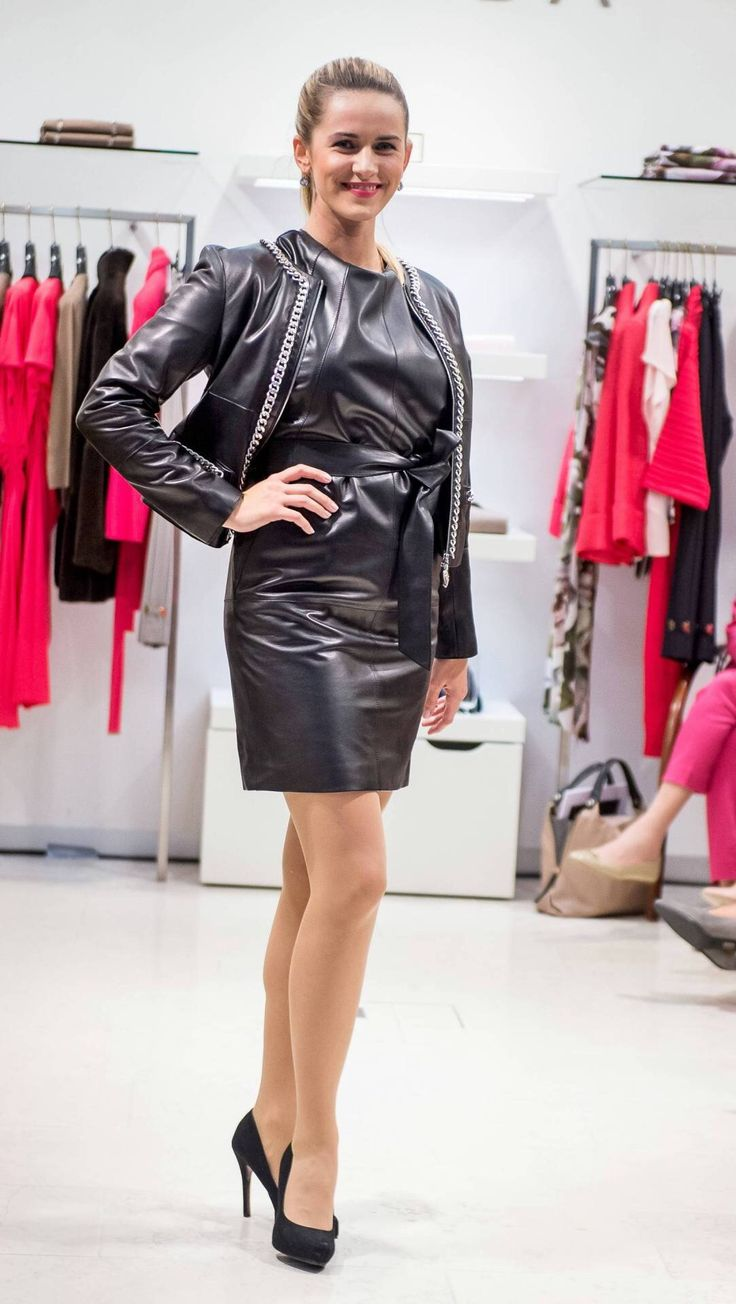Belted black leather dress and jacket ensemble