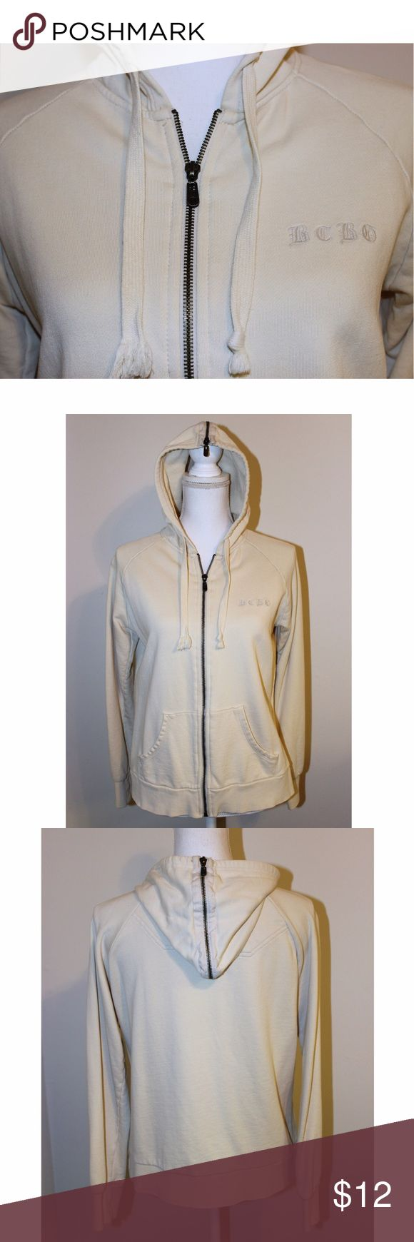 """BCBG Max Azria Beige Hoodie This is a great casual jacket! It has the BCBG logo on the front side, 2 front pockets, and zipper embellishment on the hood. It is made of all cotton. Measurements: Armpit to armpit 20"""" - Waist and hips 39"""" - Length 27"""". The jacket is by BCBG Max Azria and is size Large. It was worn maybe once or twice, but is like new - without flaws. BCBGMaxAzria Jackets & Coats"""