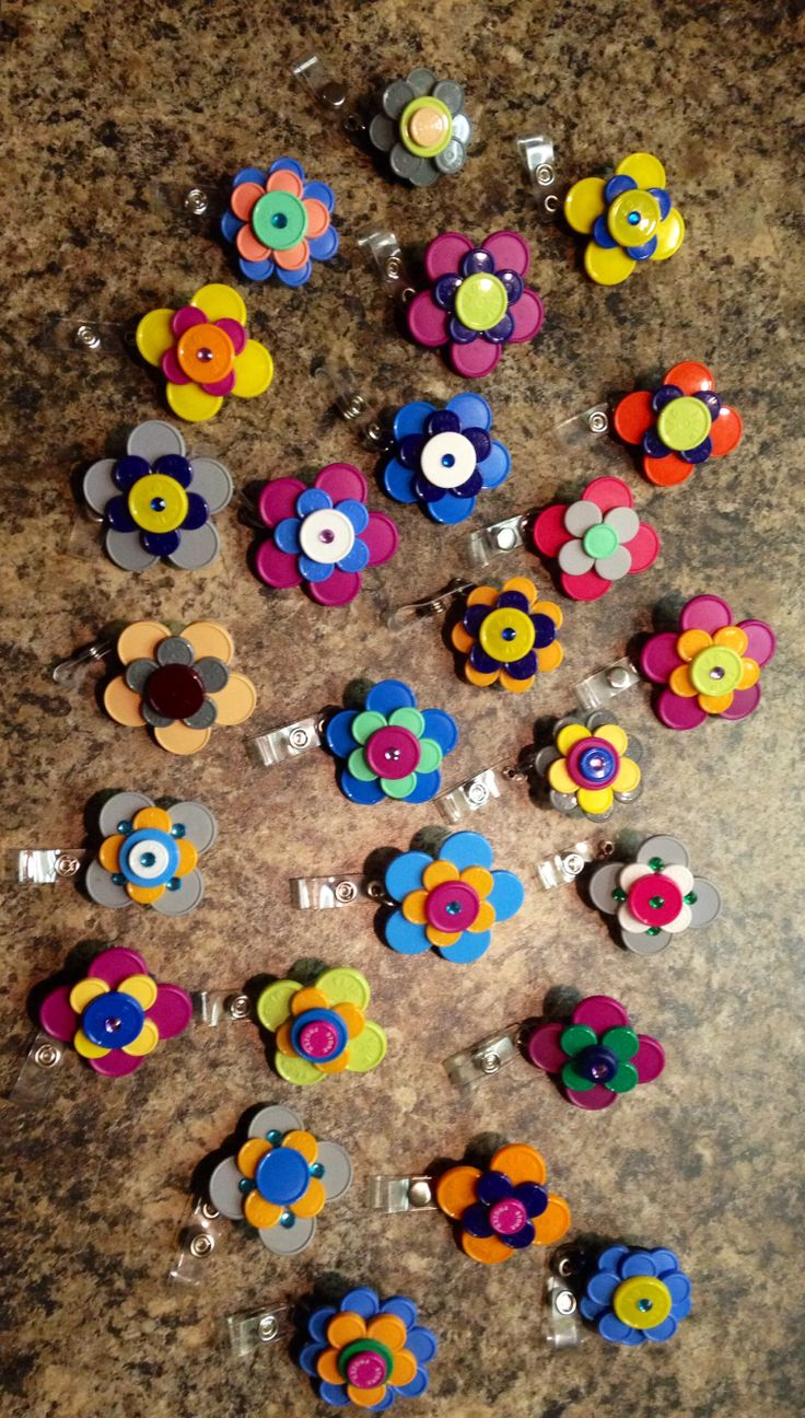 I'm attempting to start making these... flowers, animals, and such with vial tops, and glue them to badge holders.  Anyone interested??  I can custom make them for favorite sports team, specific profession (LPN, CNA, etc)... just let me know.  Still practicing right now!!  :)