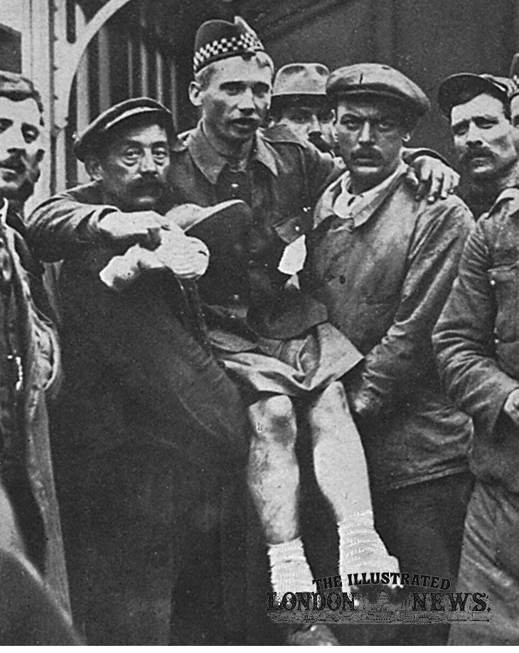 A wounded member of the Highland regiment is carried on board a ship bound for Folkestone by locals at Boulogne