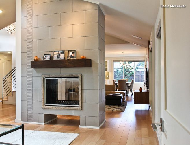 Fireplace surround with floor-to-ceiling vertical stripe ...