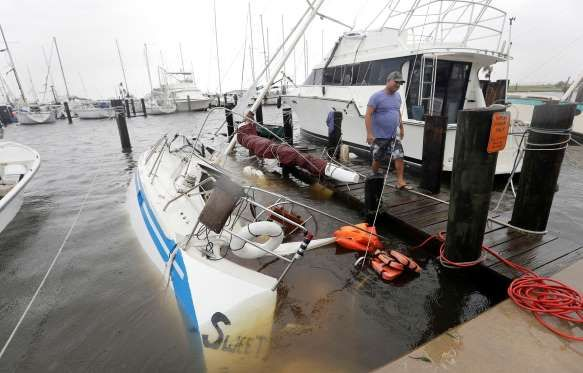 Hurricane Harvey - Robert Zbrane stands next to his sunken boat, Saturday, Aug. 26, 2017, in Rockport, Texas. Zbrane tried to ride out the storms until his boat was damaged and sank.
