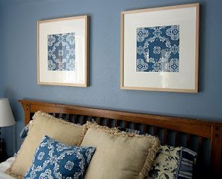 DIY inexpensive wall art    Above is a picture of our bedroom, where I simply framed two squares of fabric to tie the room together.  Another easy, inexpensive wall art project.