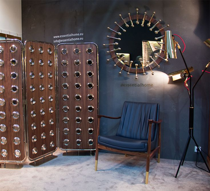 Monocles Screen is a refined room divider. The folding brass structure holds three walnut panels with brass holes that let you glimpse into the other side.