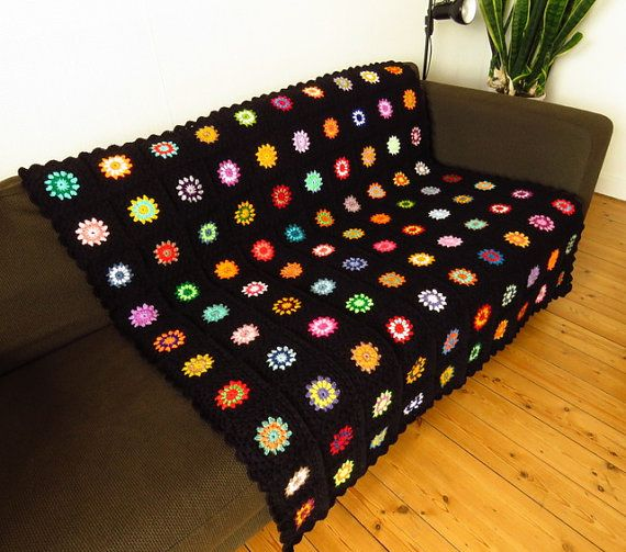 Black edged colorful #crochetblanket. Available to buy from https://www.etsy.com/uk/shop/Phoenixsmiles. Lots of colorful creations in store, why not take a look?