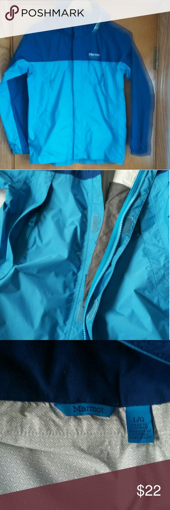 """Marmot Rain Parka Boys L Lightweight shell hooded, rain parka. Large mesh lined zip pockets. Generous hood with visor, rolls into collar. Excellent condition. 🚩 will measure soon. I am 5'5"""", size 0/2 and it is just a bit small for me. 🚩tiniest black spot at left side, in last photo. Marmot Jackets & Coats Raincoats"""