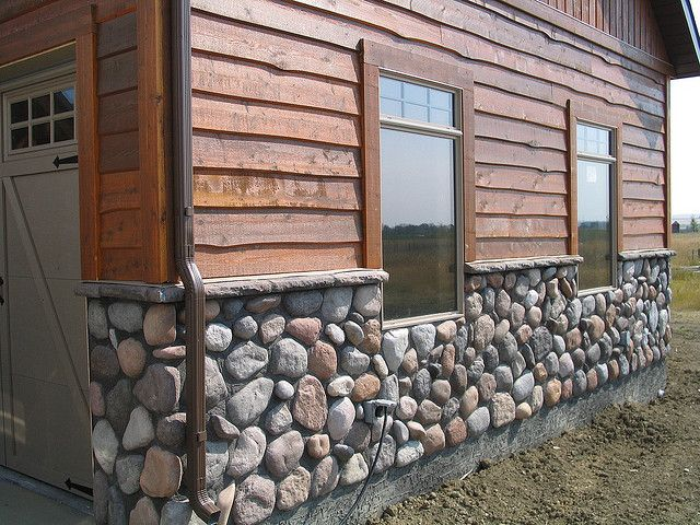 cedar siding with river rock homes