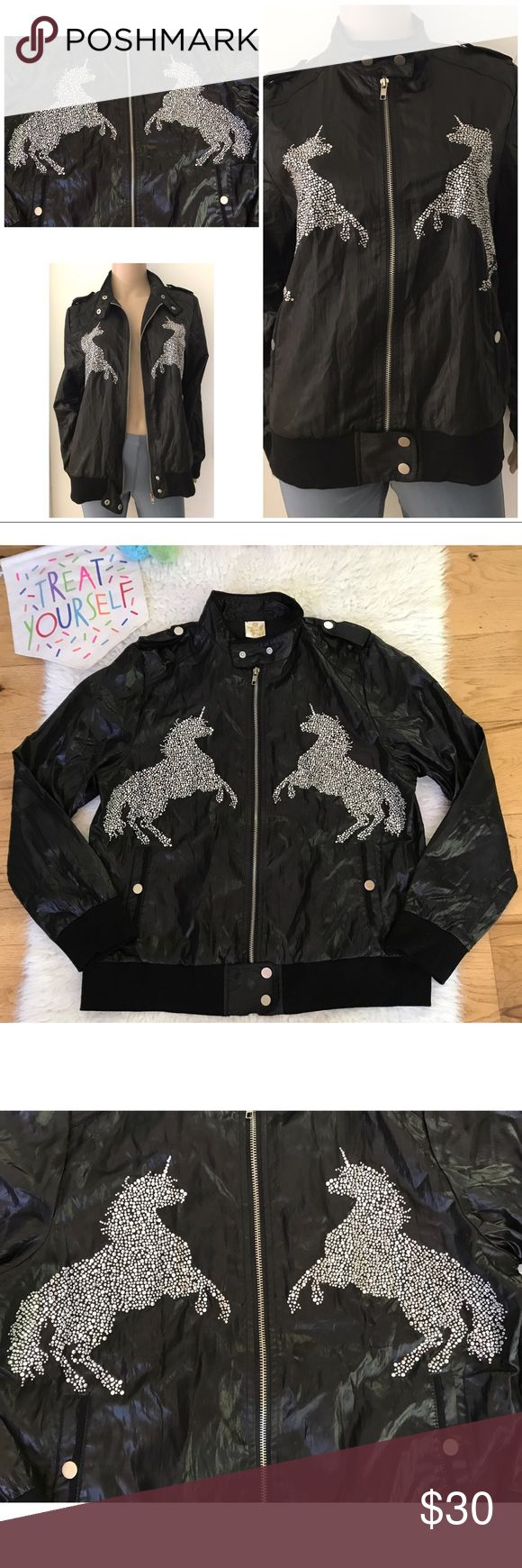 """EUC Rhinestones Unicorn Windbreaker Moto Jacket Super amazing and fun Embellished crystal unicorn Moto style nylon like jacket. Materials and size tag is not there, but Fits like a small to maybe medium. Remind me of 90s style Windbreaker jacket. No major flaws. Measure about 24"""" length, 20"""" pit to pit, 23.5"""" sleeves, 15.5"""" shoulder to shoulder. Snap buttons an zipper closured. Pockets on the side. ❌No trades or modeling. Open to reasonable offers. Bundle more to save more. Thank you‼️…"""