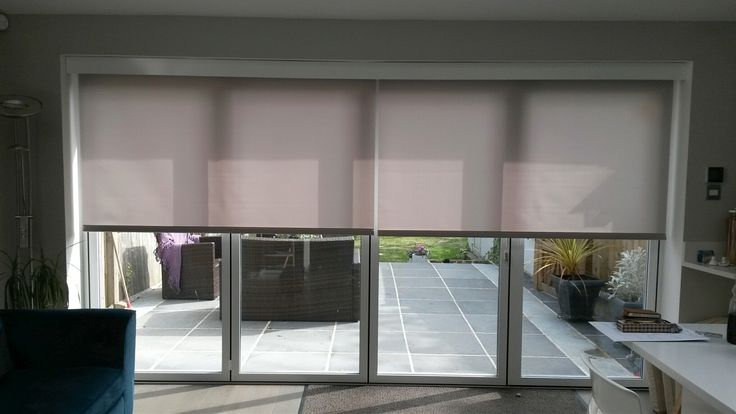 Electric Blinds covering your bifold doors will reduce unwanted heat, glare and UV by Deans Blinds & Awnings
