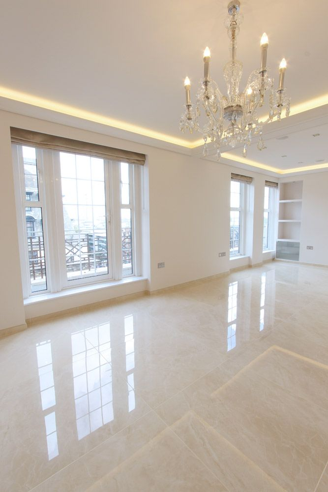 Elegant Penthouse Living Room With Glossy Floor Tiles With A Marble