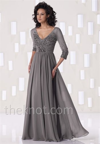 Dress features beading and 3/4-length sleeves. Silhouette: A-Line  Waist: Empire  Gown Length: Floor  Sleeve Style: Sheer  Fabric: Chiffon  Embellishments: Beading  Color: Smoke, Navy Blue or Brown  Size: 4 - 26W