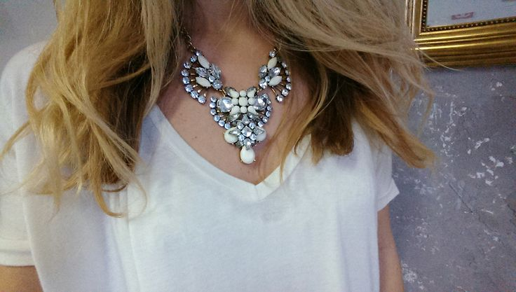 Wearing statement crystal necklace.