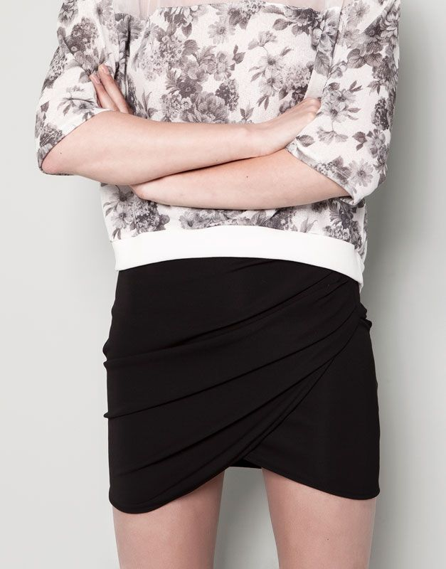 :SKIRT WITH SIDE DRAPE DETAIL