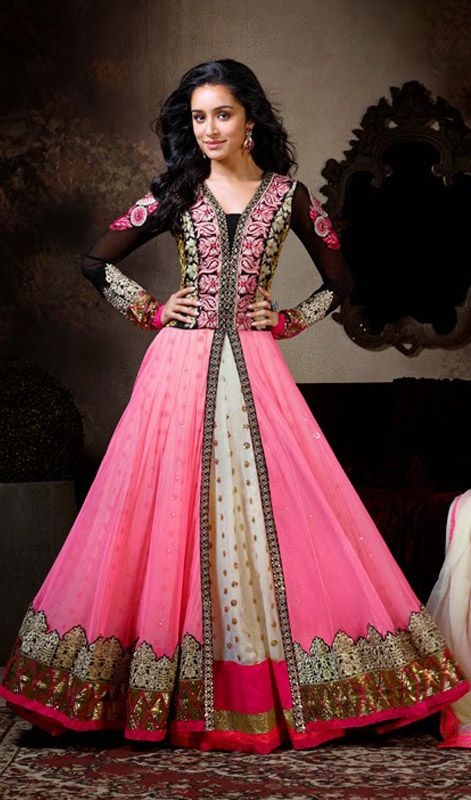 Shraddha Kapoor Pink Layered Long Anarkali Churidar Suit Look scintillating like Shraddha Kapoor donned in this pink and cream shade faux georgette layered long Anarkali churidar suit. Contrasting yoke beautified with heavily resham and crystals embellished foliage patterns amasses the charm. Center slit of the first layer portrays sequined buttis on the second layer. Contrasting hemline patches proliferate the beauty of the attire. #LongAnarkaliChuridarSuit #DesignerAnarkaliSuits