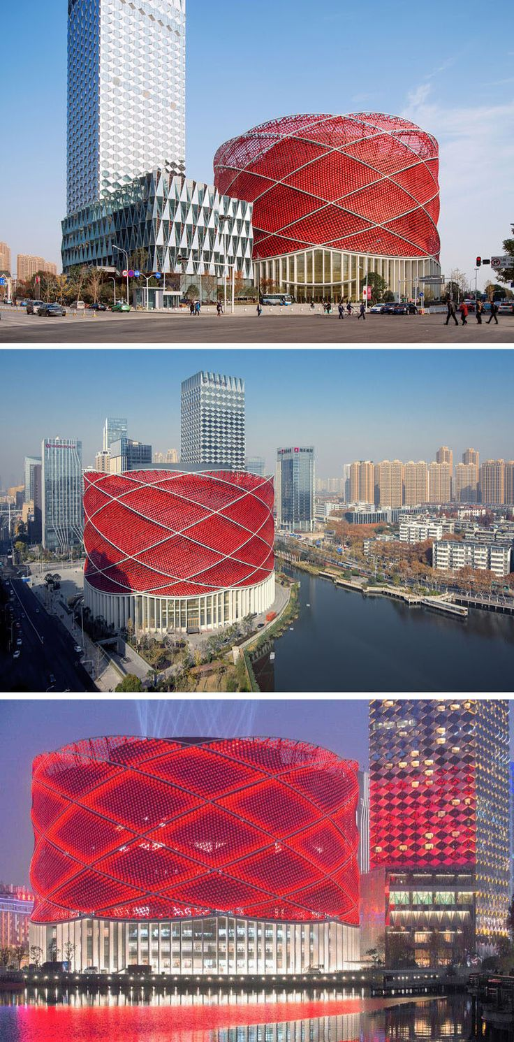 11 Red Houses And Buildings That Aren't Afraid To Make A Statement // Red concave aluminum disks are used to create the look of a red Chinese paper lantern on the exterior of this entertainment theatre.