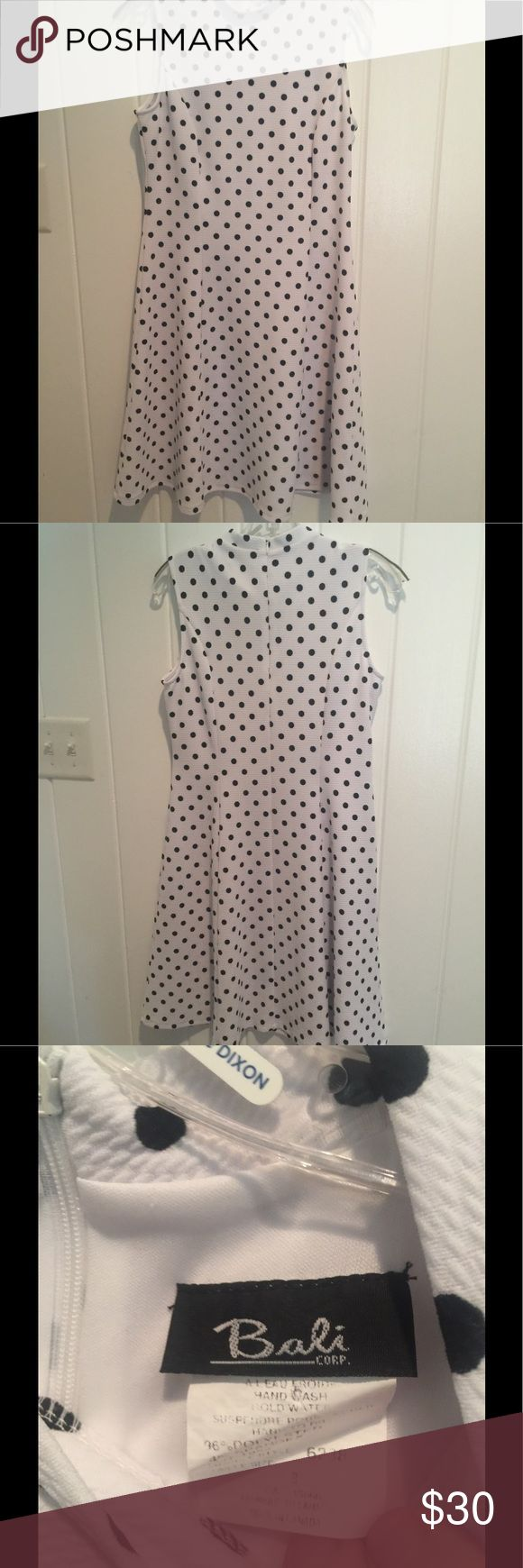 White with Black polka dot dress.  Size 8 With a mock neck and a swing in the bottom, this is one sleeveless flirty dress. I wore it once, with a blue cashmere wrap.  Staying true to my mission of cleaning out,  it must go, but I hate for it to go. BALI CORP Dresses