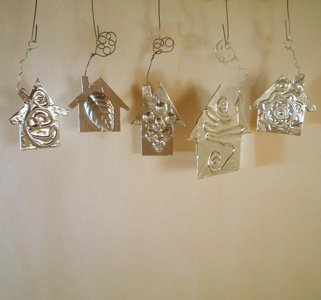 ornaments or jewelry made out of silver duck tape