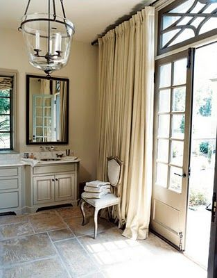 Drapes around full wall windows