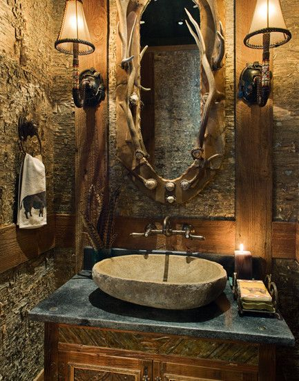 Rustic Bathroom with a very cool antler mirror