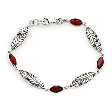 This delicate yet captivating sterling silver leaf and garnet bracelet will make an excellent accent to many outfits. The fine sterling silver craftsmanship features a detailed leaf design that gives this piece its unique charm. $99.77 #ilovetoshop