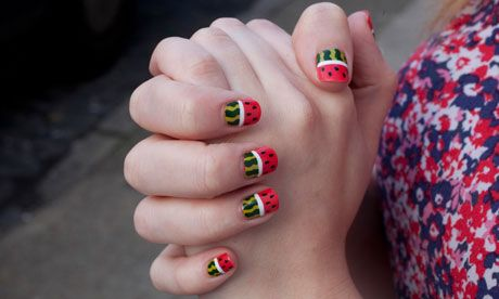 Fingernails painted with a watermelon design