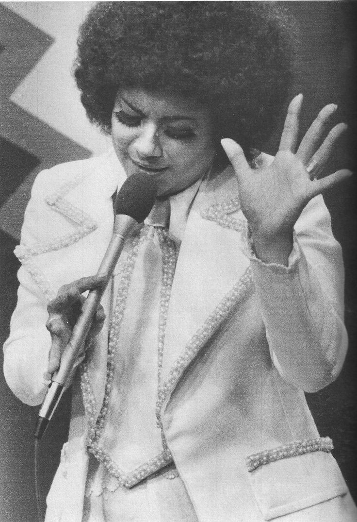 Lucecita, musician and activist, was blacklisted from Puerto Rican television during the early 1970s for her refusal to whiten her appearance and for her support of revolutionary movements in Puerto Rico and Cuba (many Puerto Rican television stations were owned and staffed primarily by white cuban exiles). In response to the harsh criticism she drew due to her adoption of what was referred to by the Puerto Rican press as 'the African look',Lucecita released songs that [read more].