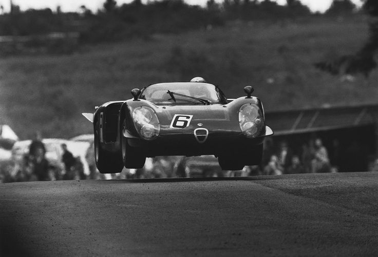 The Alfa Romeo T33/2 of Nino Vaccarella, Mario Casoni and Ignazio Giunti gets some serious air at Brunchen during practice for the 1968 Nürburgring 1000kms.