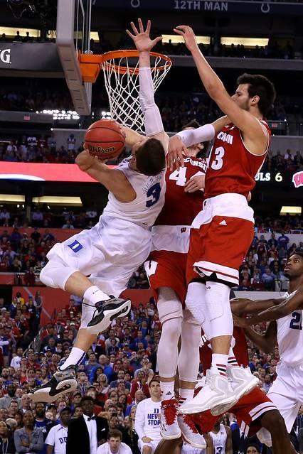 Grayson Allen drives to the basket against Frank Kaminsky.