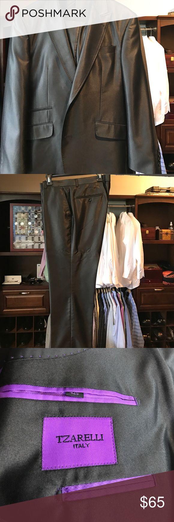 Slim Fit Italian black shiny Men's Suit 42S This is an Italian Slim fit Men's Suit 42S pants are 36 Slim Fit and 28 long sim plus one inch. Shiny Black. Suits & Blazers Suits