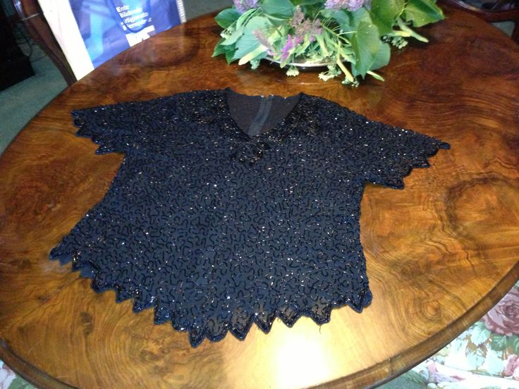Luxurious evening black t-shirt in chiffon, beads and rhinestones with an extremely sophisticated scallop fringe