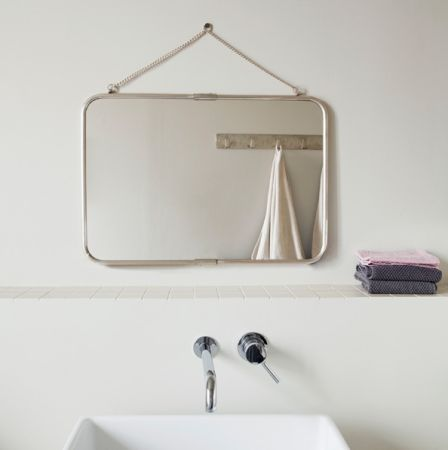 hanging mirror over the sink feels much less imposing than a huge wall-mounted one