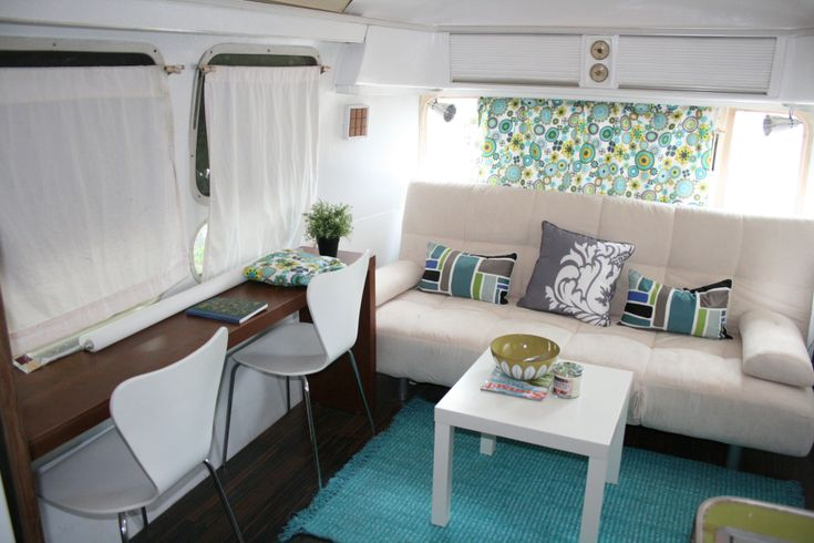 Airstream remodel with lots of before and after pics. I like the bar-style counter top.