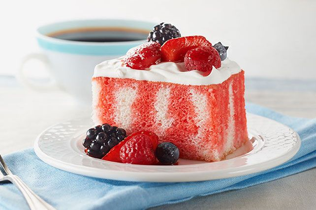 KOOL-AID gives fresh berries an instant glaze look as well as a sweeter flavor making this cake stand out at your party table.  JELL-O turns Summer into fun! It not only adds flavor to this basic white cake, but it also adds a colorful twist.