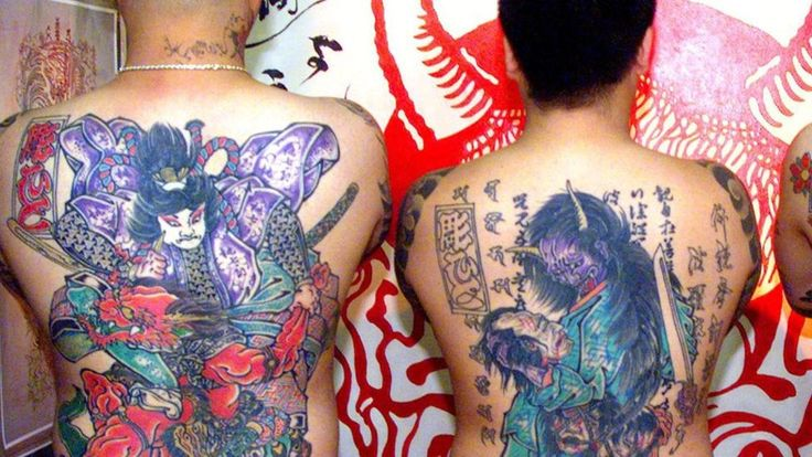 Japanese spas urged to relax tattoo rules for tourists - BBC News
