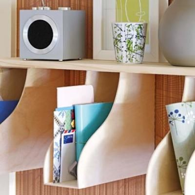 Easy access wall pockets made by hanging office organizers sideways.  Perfect for those little scraps of leftover paper that are just big enough to possibly use again but too small to keep track of... you know what I'm talking about.