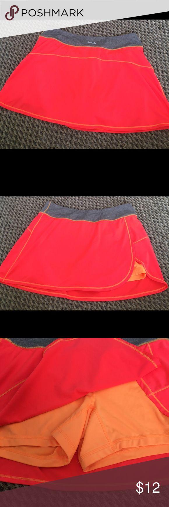 Fila Tennis Skort Fila Tennis Skort   Size Medium   Excellent condition   Add to a a bundle and I'll send you a offer!   Fila Shorts Skorts