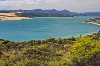 Beautiful colored waters of the Hokianga harbour near Omapere on the North…