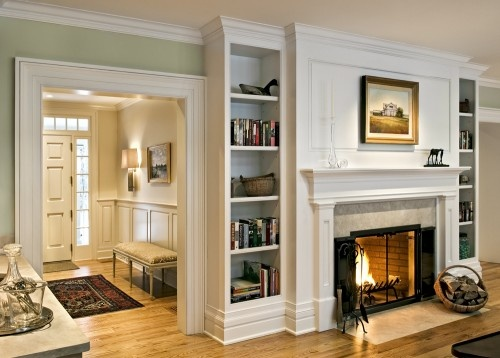 Entry way and living room. Cozy fireplace.