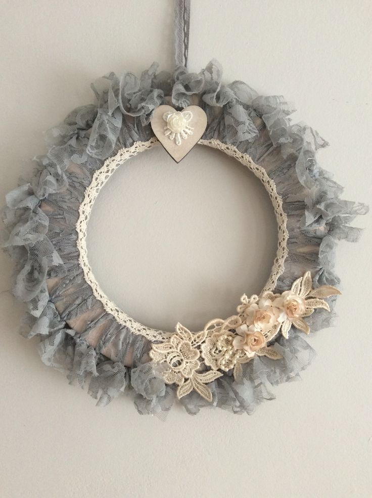 Handmade shabby chic grey lace wreath with lace appliqué and flowers.