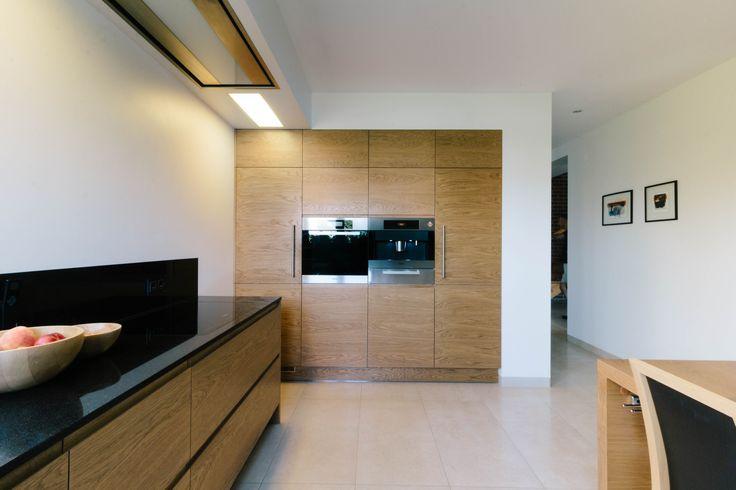Modern wooden kitchen with black worktops
