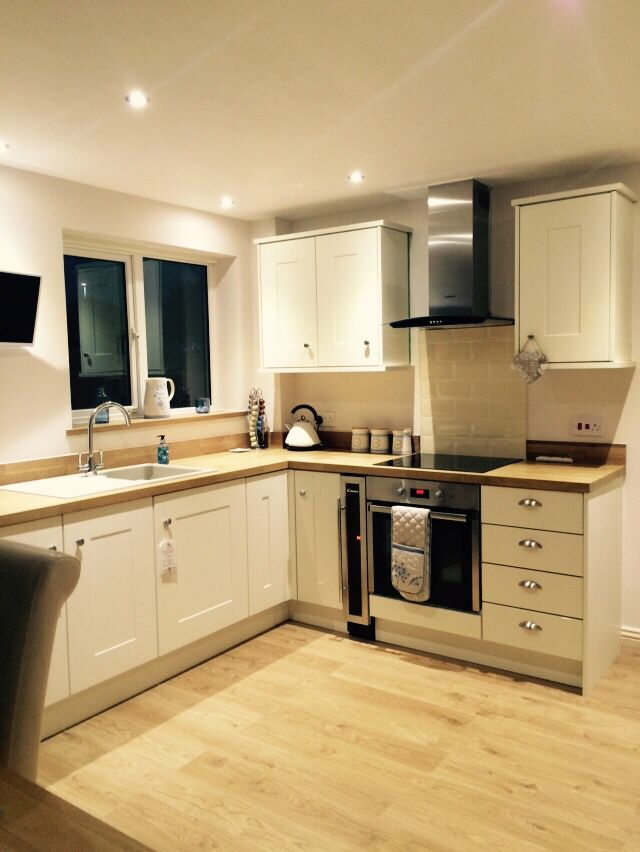 Cream shaker style kitchen with solid oak worktops