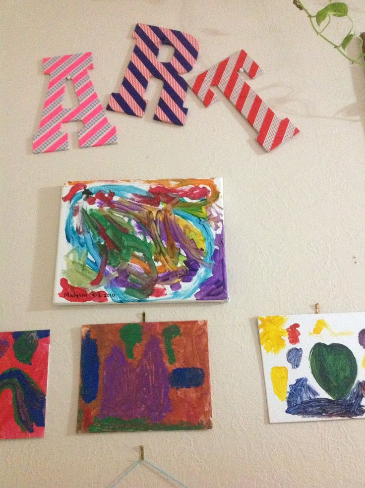 My kids art wall, used washi tape on wood letters.