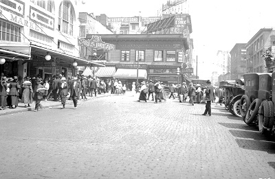 Looking east up Pike Street from Pike Place Market, 1919