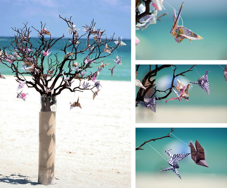 Cranes hung off branches in a glass vase filled with sand. Beautiful! 1000-Cranes-Wedding