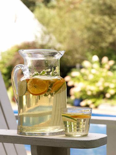 Greek White Sangria  Serve a refreshing white wine sangria with your summer Greek feast. Apricot nectar sets this punch apart from traditional sangria.