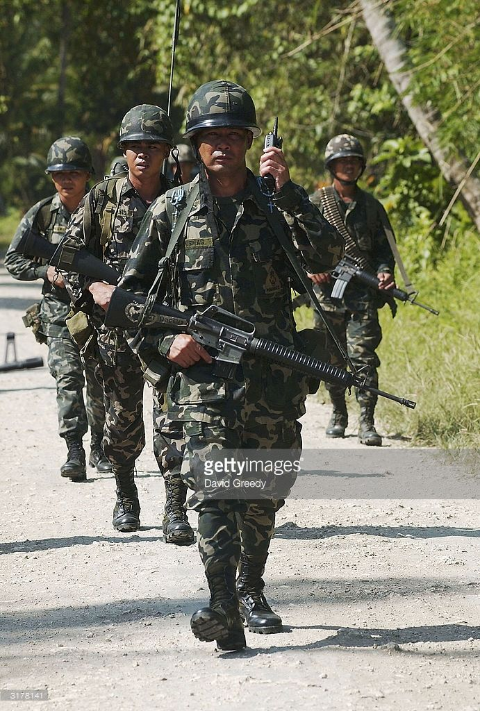 Philippine marines from the 3rd Battalion resume patrols around a former Moro Islamic Liberation Front stronghold on March 31, 2004 near Pikit on the troubled southern island of Mindanao, Philippines. On Sunday, a Malaysian advance peace monitoring team visited the region and the MILF were allowed to re-occupy former bases in the area only for the meeting. Various Muslim separatists have been fighting government forces for the past three decades in the resource rich southern island. Formal…