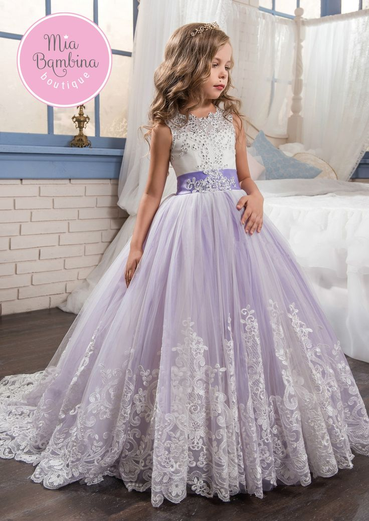 The New Jersey flower girl dress is a sleeveless floor-length ball gown for little girls. Tank bodice features rich rhinestones embroidery throughout, a keyhole opening, and a lace-up corset back with