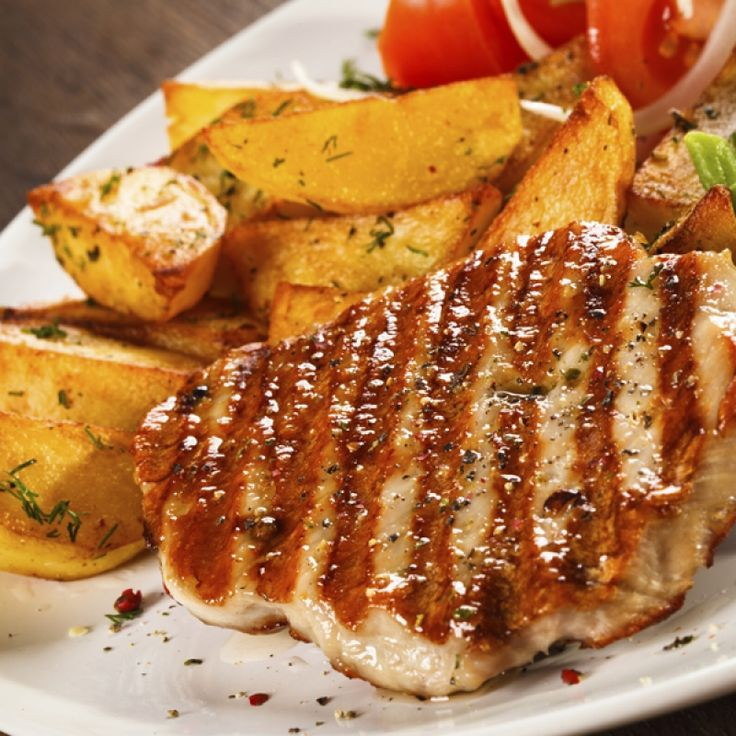This tasty looking grilled pork steak is perfect with roasted potatoes.. Grilled Pork Steak  Recipe from Grandmothers Kitchen.