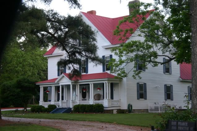 white house with red metal roof best farmhouse exterior ideas