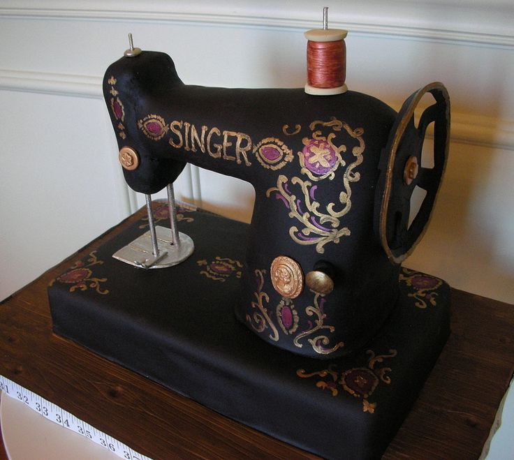 Vintage Singer Sewing Machine.  YES, IT IS A CAKE!  Everything you see is handmade of sugar and completely edible except for the tape measure and dowels!